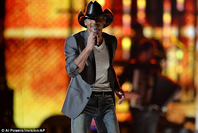 Country star: Tim joined the eclectic mix of songwriters assembled for the big gig