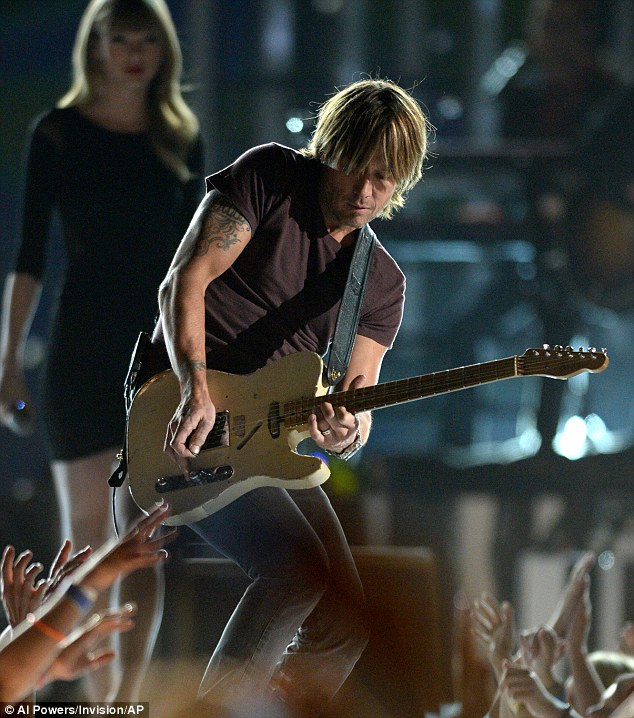 Country guitar strum: Keith Urban rocked out on stage, just a day after his performance at the ACMs