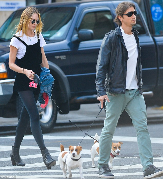 Model couple: Candice Swanepoel spent her day off on Monday with boyfriend Hermann Nicoli walking their dogs in downtown Manhattan