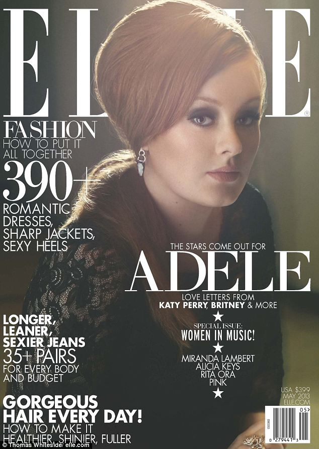 Beehive: Adele appears on the cover wearing her trademark beehive hair do in a flattering black lace dress