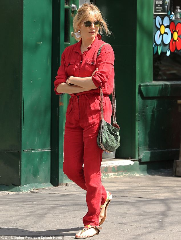 Style icon: Sienna Miller stepped out in New York on Tuesday wearing a bright red jumpsuit