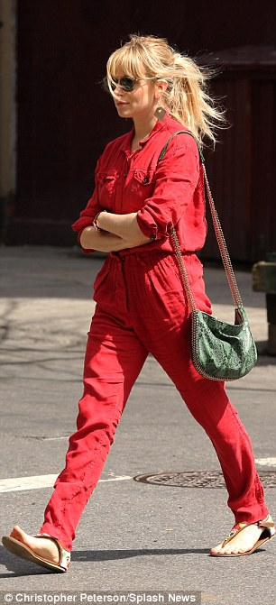 Baggy: Sienna may have a very slim frame but she chose to keep it covered in the loose fitting red jumpsuit