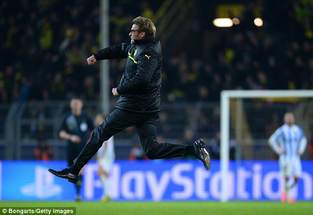 Pitch invasion: Dortmund head coach Klopp leaps with delight at the final whistle