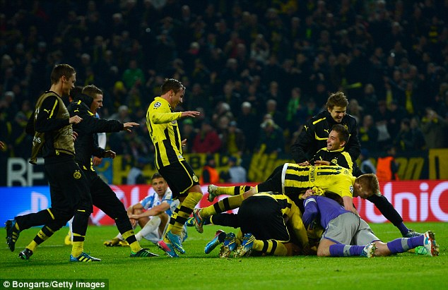 Jubilation: Dortmund players celebrate their remarkable win