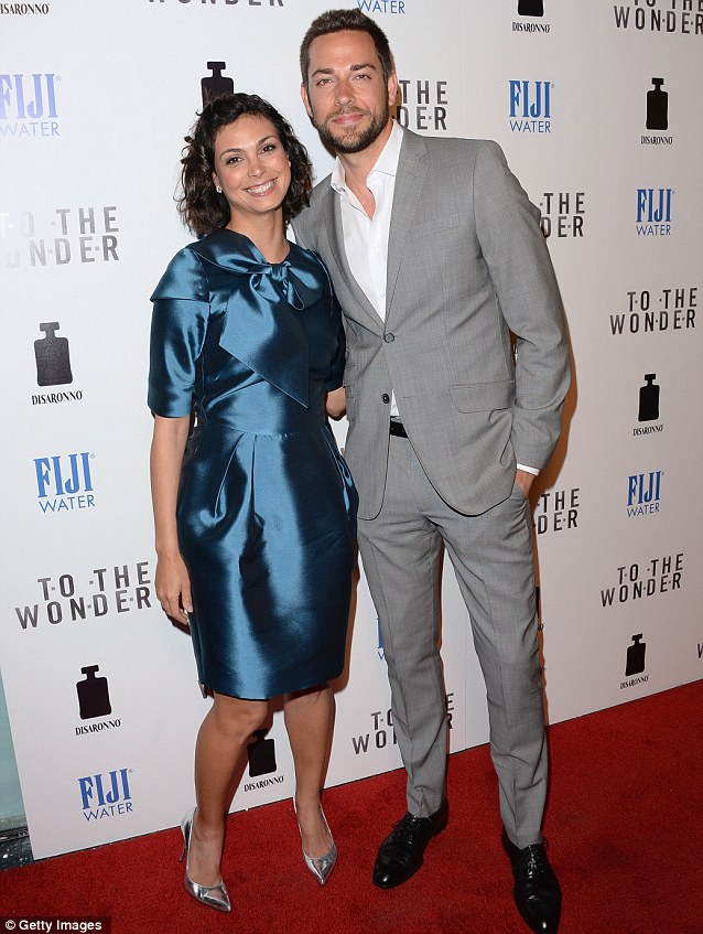 A handsome pair: Morena was joined by smartly dressed actor Zachary Levi on the carpet