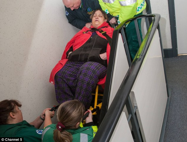 Crippling: Carol is so overweight she cannot get to the hospital without specially-trained paramedics equipped to deal with obese patients