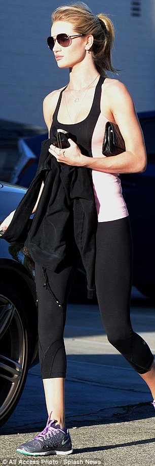 Looking good: Rosie put everybody to shame with her super slim figure, which was highlighted by her very clingy gym gear