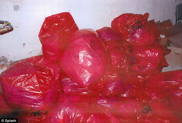 Discovery: Investigators found these bags allegedly filled with body parts at the clinic in Philadelphia
