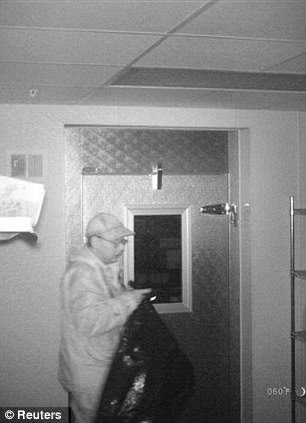 Caught in the Act: Christopher Knight is shown in this 2012 surveillance photo released by Maine State Police on April 10, 2013