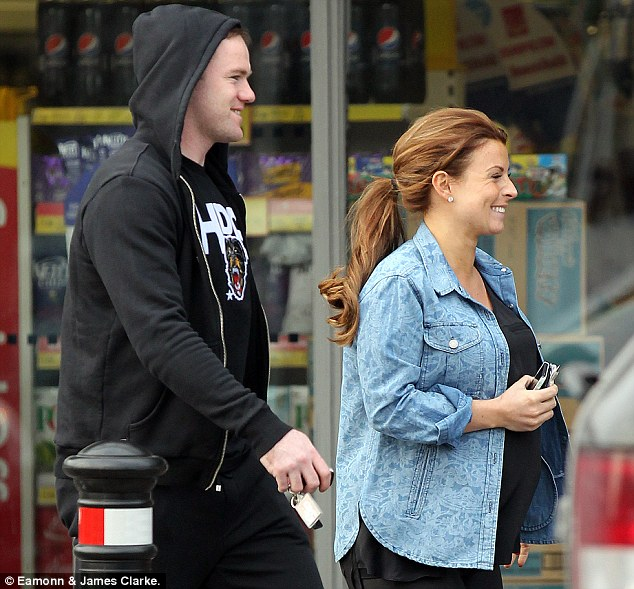 All smiles: Wayne grins alongside his pregnant wife Coleen