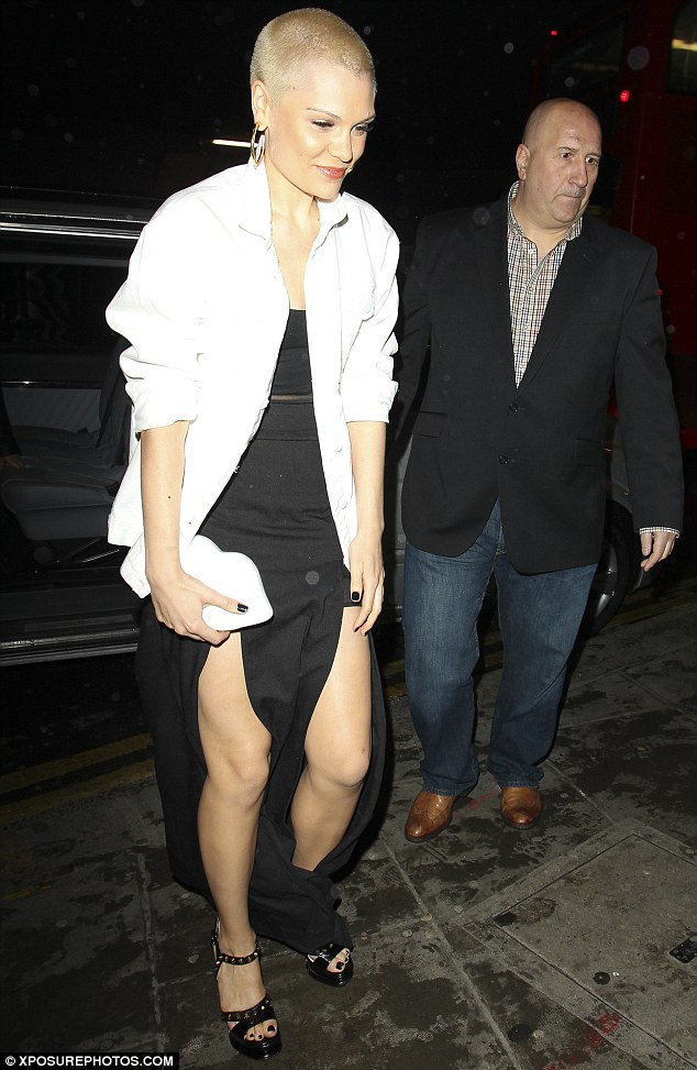 Covering up: Jessie carried a white lips clutch bag and wore a white blazer over her black dress as she headed home from the event