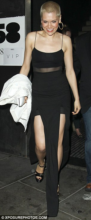 Gamine: Jessie drew attention to her slim figure by wearing a strappy black dress featuring thigh-high splits on both legs