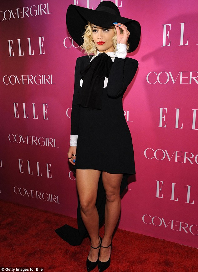 Tipping her hat: Rita sported bright red lipstick, and blue nail varnish, adding a splash of colour to her ensemble