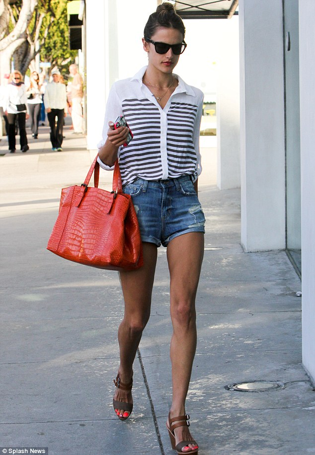 Pampering session: Alessandra Ambrosio, who turns 32nd on Thursday, wore a pair of tiny denim shorts and a white and navy shirt as she headed to a nail salon in Beverly Hills on Wednesday