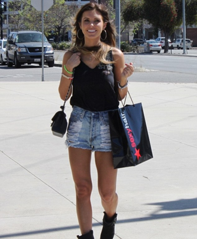 Audrina Patridge smiling while out and about in Los Angeles sporting Haute Betts bracelets and taking home hair products courtesy of Sexy Hair on Wednesday, April 10th.