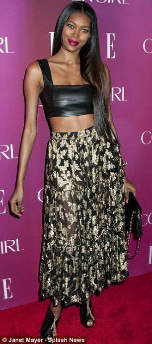 Showing some skin: Model Jessica White flashed her toned tummy  and showed off her extremely slim arms, while designer