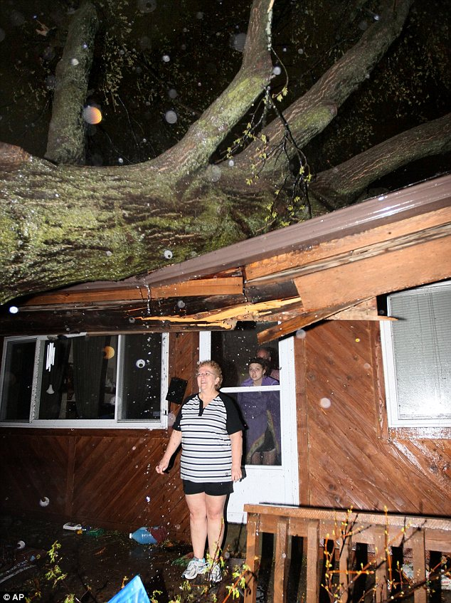 Lucky to be alive: Susan Strebeck stands outside her Hazelwood home, which was struck by a fallen tree