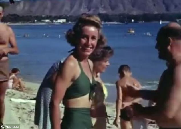 Sunny: A far cry from the rain in London, those in Hawaii lapped up the sun on the beach on VJ Day