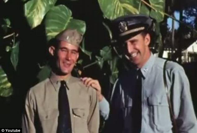 All smiles: The relief and happiness is etched all over these two military men on VJ Day