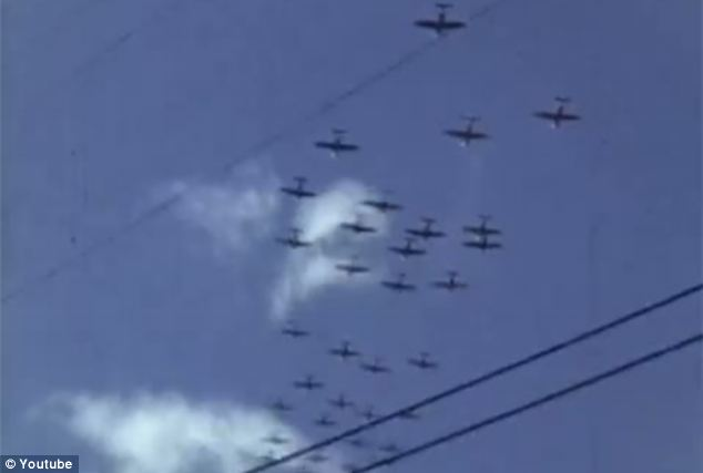 Fly past: The restored footage captures a group of fighter planes flying over Hawaii