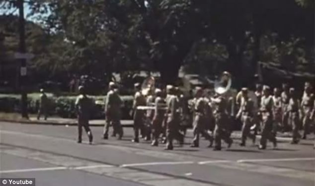 Entertainment: A marching band takes to the streets to celebrate after days of rumours and speculation that the war was coming to an end