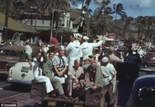 The end of the war: VJ Day was declared a two day holiday in the US, Britain and Australia as celebrations broke out to mark the Japanese surrender