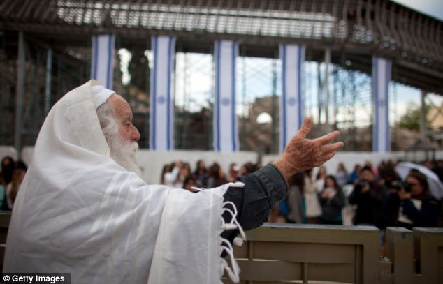 An Orthodox Jewish man chants slogans against members of Women of the Wall