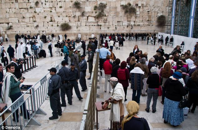 Police set up a buffer zone between the men's and women's sections at the Western Wall to in an attempt to prevent confrontations between Orthodox Jewish men protesting the manner of prayer practised by Women of The Wall
