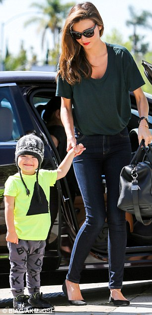Taking turns: After Miranda's morning with Flynn, her husband Orlando Bloom took over parenting duties