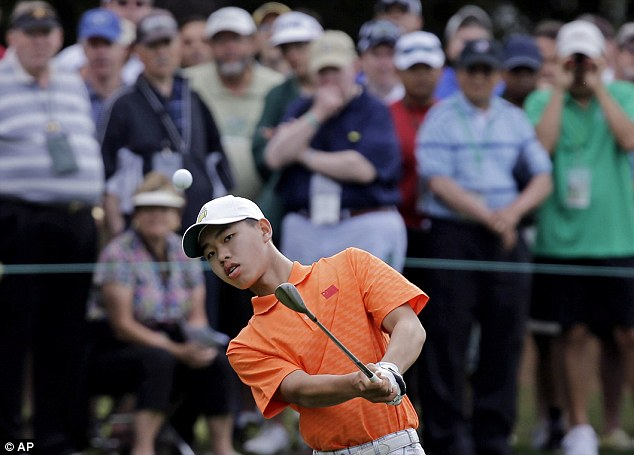Holding his nerve: 14-year-old amateur Guan Tianlang, of China, chips to the first green