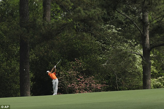 In the swing: Guan Tianlang hits off the second fairway during the second round on Friday