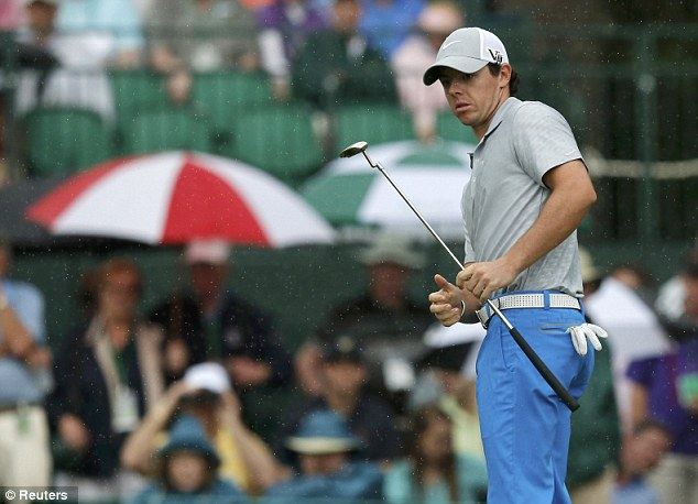 Not at his best: Rory McIlroy hits to the first green, where he made bogey, during the second round