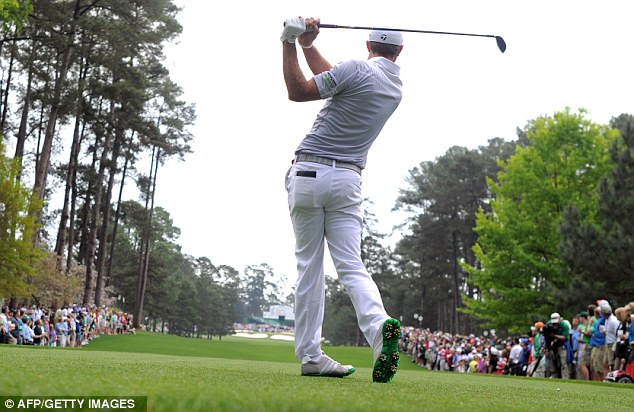 Big hitter: Dustin Johnson tees off during the second round of the 77th Masters