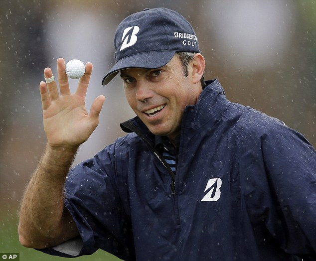 Smiling as usual: Matt Kuchar holds up his ball after sinking a putt on the second green