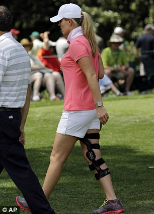 Braced: Lindsey Vonn follows boyfriend Tiger Woods' round on Friday - she injured her knee in a skiing accident earlier this year