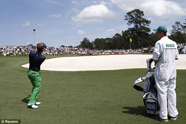 Short-game specialist: Englishman Luke Donald chips to the second green during his second round