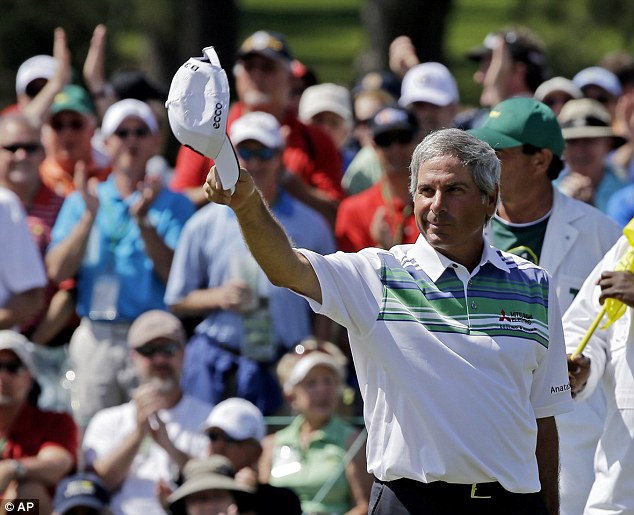 Still got it: Fred Couples, 53, tips his cap after a birdie on the 18th green gave him the clubhouse lead