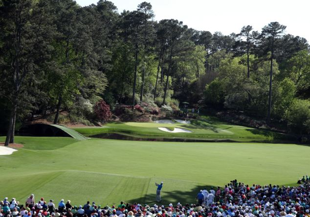 Signature: Zach Johnson hits a tee shot on the 12th hole, the famous par-three Golden Bell