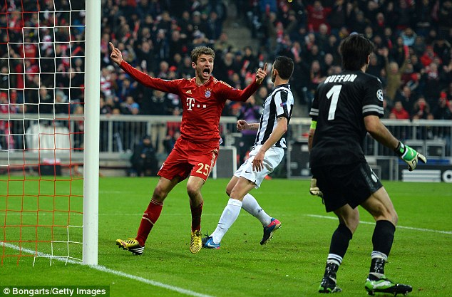 That'll settle it! Thomas Muller celebrates after scoring the goal to put Bayern 4-0 up on aggregate against Juventus