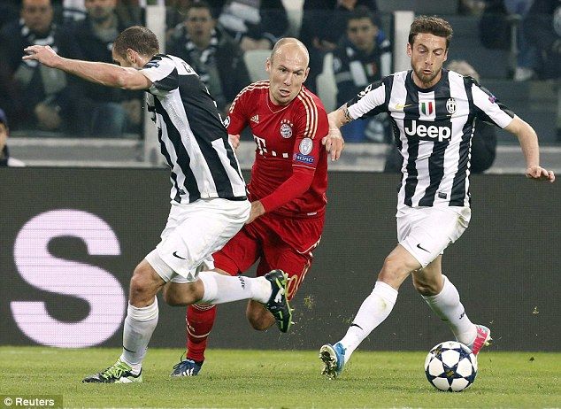 Flair: Arjen Robben squeezes between the challenges of Juventus players Giorgio Chiellini (left) and Claudio Marchisio (right)