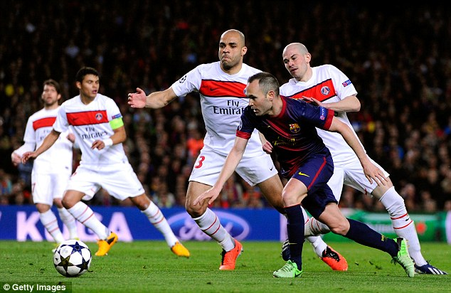 Shackled: Xavi tries to get away from PSG players Alex and Christophe Jallet during this week's quarter-final second leg