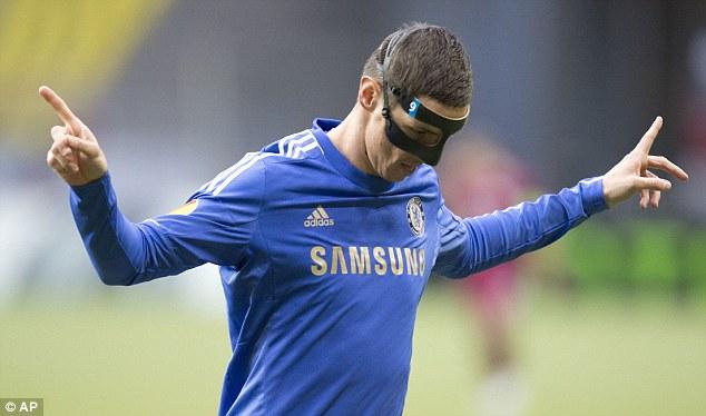 Masked marauder: Fernando Torres celebrates his goal against Rubin, his fourth in the Europa League this season