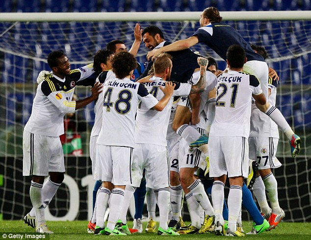 We're through! Fenerbahce celebrate after their 1-1 draw against Lazio took them through 3-1 on aggregate