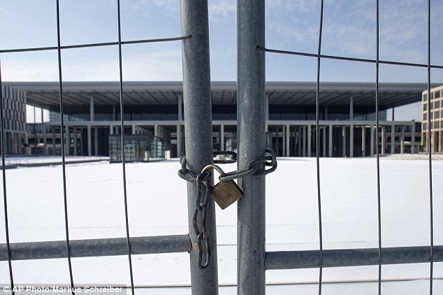 Red-faced: Willy Brandt International Airport was supposed to open in late 2011. Instead, it is still closed and is fast becoming a source of national embarrassment
