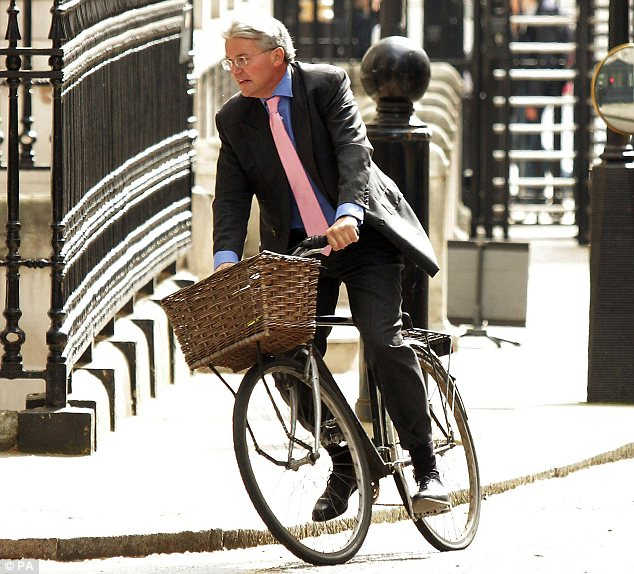 On his bike: The minister was accused of swearing at police who stopped him riding his bicycle through the main gate of Downing Street and subsequently resigned from his post