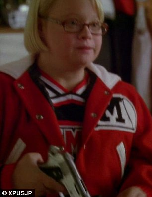 All a mistake: It is later revealed that Downs Syndrome student Becky had brought a gun to school for her own protection but, while she shows it to Coach Sue Sylvester in her office, it accidentally goes off