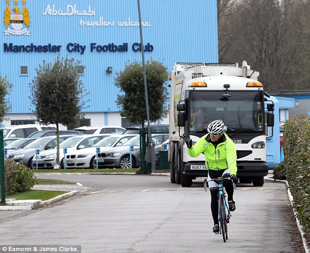 Road to Wembley: Roberto Mancini left Manchester City's Carrington training base on his bike today