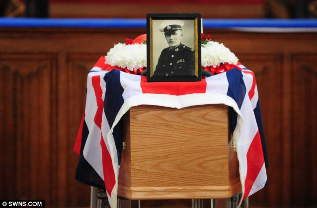 Commemoration: A photo of Mr Vaughan in his Royal Marine uniform sits on top of the coffin as his life is commemorated