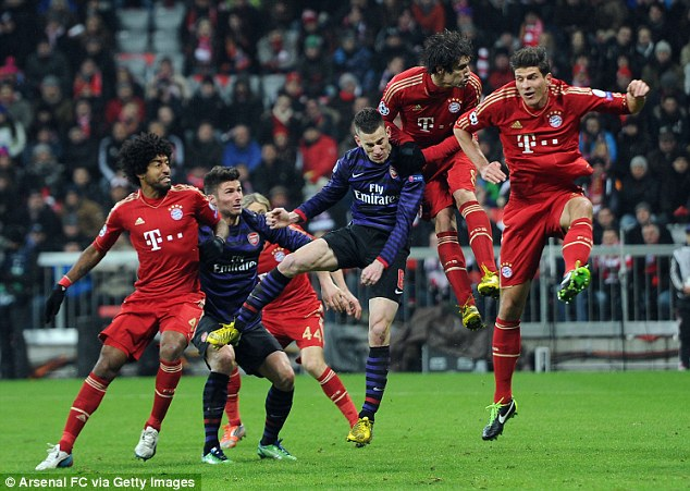 Eye for goal: Koscielny scored Arsenal's second but was unable to prevent them going out at the Allianz