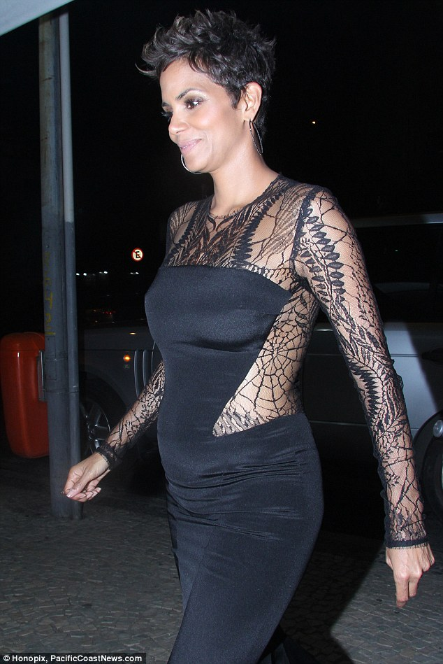 Maternity glamour: Halle wore a stunning black satin and lace dress at The Call premiere in Rio de Janeiro on Thursday night